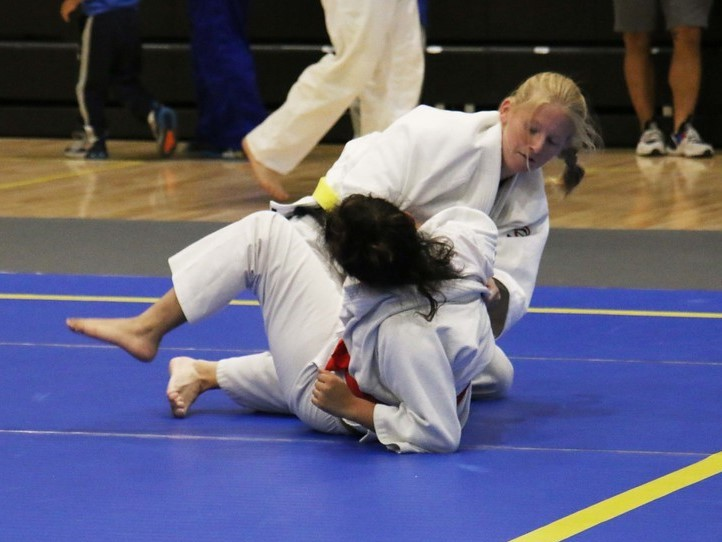 Female judokas in newaza during a judo competition