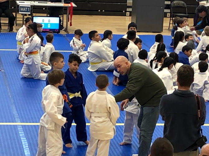 Sensei Kevin Costello coaching at a kids judo competition