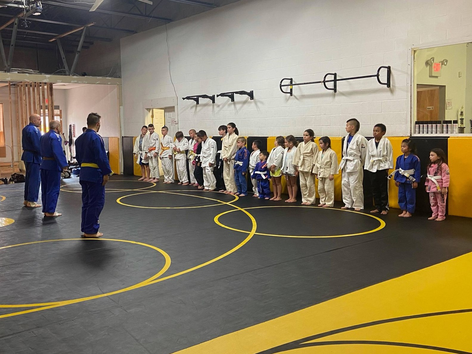 Lining up for a kids judo competition